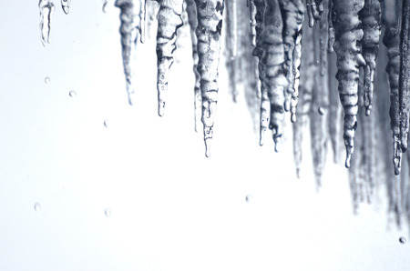 winter thaw: Cold icicles dripping with water behind Niagara Falls
