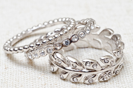 Silver rings with crystals in arrangement