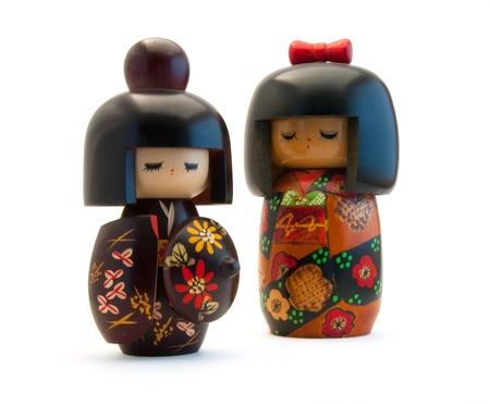 Kokeshi Dolls op wit wordt geïsoleerd