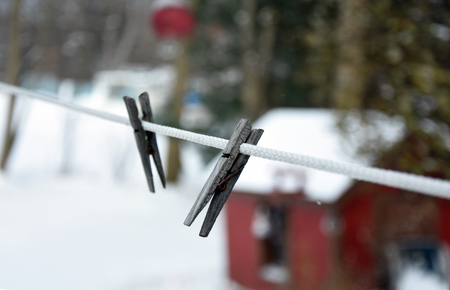 Old Clothespin on clothesline in winter