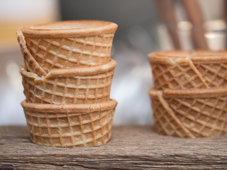 shelf ice: Out of focus half of ice cream cones on wooden shelf