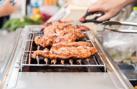 asian cooking: Thai spicy roast pork cook on barbequeue, selectve focus