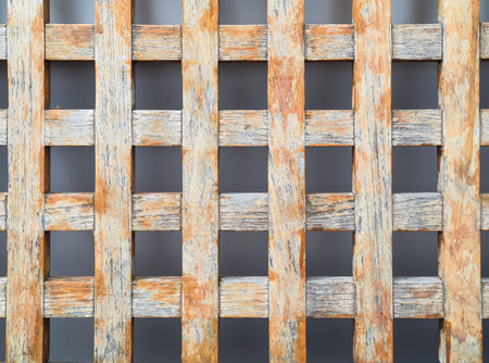tabular: Back of a wooden chair on grey background