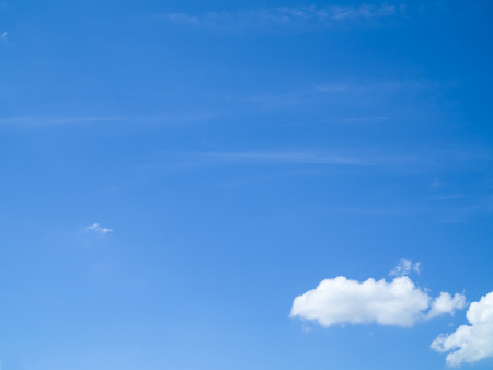 nimbi: Soft clear blue sky with small cloud at the bottom