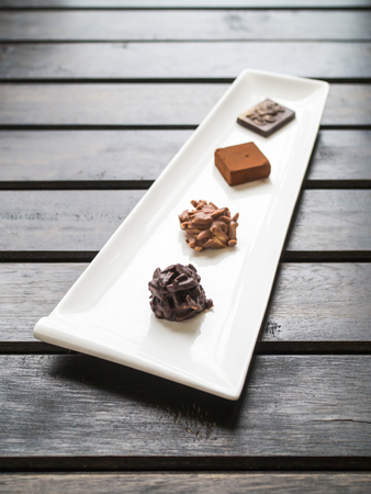 kind of: Different kind of chocolates on a white dish