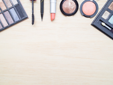 eye liner: Woman cosmetics - eyeshadow, brush on, lipstick, eye liner, mascara. Top view with space for text. Stock Photo