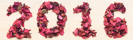arabic numeral: Year 2016 numbers, arabic numeral made from dried red flower on wood background