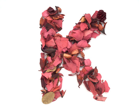 letter k: Isolated letter K - capital alphabet made from dry red flower petals