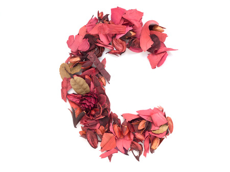 letter c: Isolated letter C - capital alphabet made from dry red flower petals