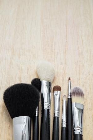 make up brushes: Selective focus on women make up brushes on wood background Stock Photo