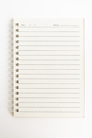 soumis: Open spiral notebook, empty line paper with date and subject at header - notebook paper on white background