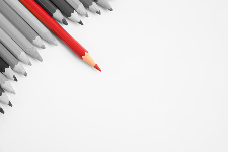 divergence: Sharp red color pencil stand out of group of colored pencils on white background - business concept of leader, leadership, unique, success Stock Photo