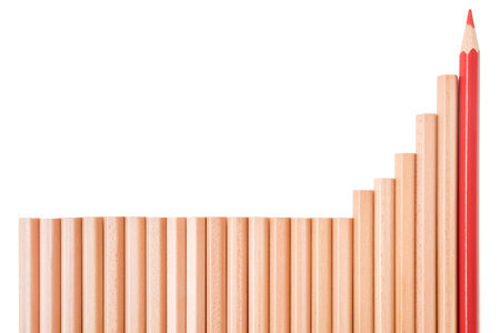 increment: Sharp red color pencil and brown pencils lay down in bar graphs shape  on white background - business concept of growth and increment
