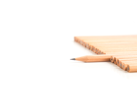 divergence: Sharp brown pencil stand out of the other brown pencils - business concept of leader, success, unique - isolated object on white background