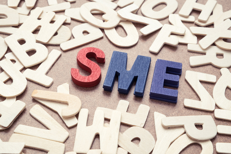 SME - Small and Medium Enterprise wording - business concept Stock Photo