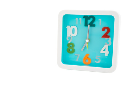 seven o'clock: Isolated light blue square alarm clock with colorful numbers - isolated clock on white background