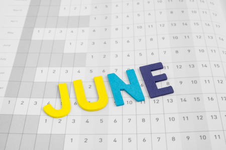 uppercase: June - month on calendar paper - colorful uppercase letter