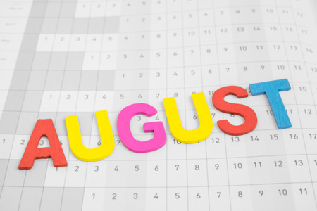 uppercase: August - month on calendar paper - colorful uppercase letter