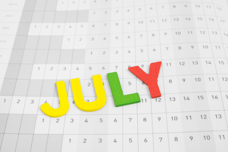 uppercase: July - month on calendar paper - colorful uppercase letter