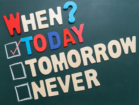 when: Business time management concept - When? Today, Tomorrow, or Never with checkboxes and red marking on blackboard