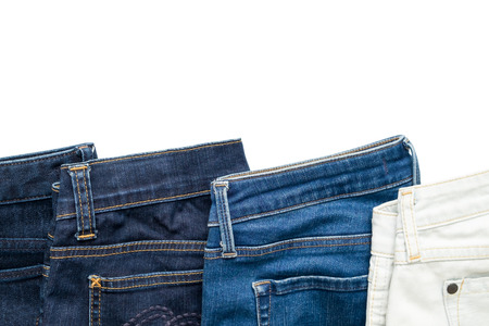 denim trousers: Isolated folded jeans denim trousers in different blue color from light to dark on white background