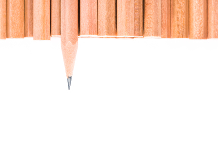 divergence: Sharp brown pencil stand out of other brown pencils - business concept of leader and success - isolated object on white background