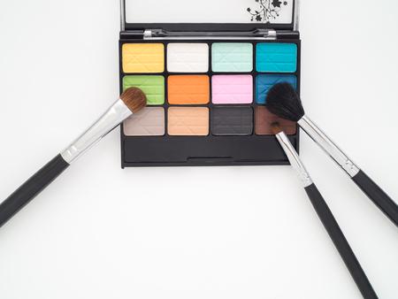 eyeshadow: Colorful eyeshadow palette with eye makeup brush - beauty cosmetics  product on white background Stock Photo
