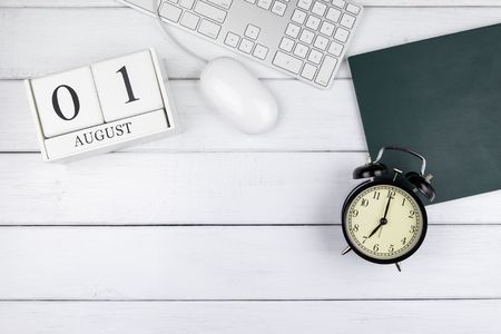 Table top view of calendar, clock, keyboard and mouse on white wooden office desk Stok Fotoğraf