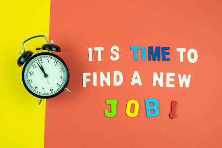 Concept of Its time to find a new job on colorful orange and yellow background with vintage clock