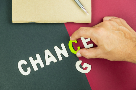 Concept of change can be a good chance - hand pick up C letter of chance wording on red and black background Stok Fotoğraf