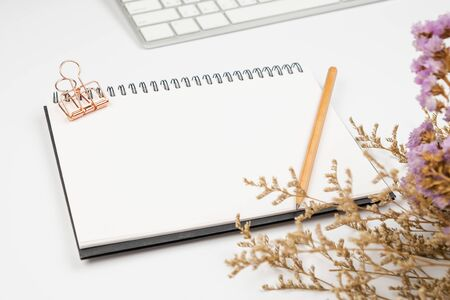 Selective focus on empty notebook pencil and paper clip on office desk Stok Fotoğraf