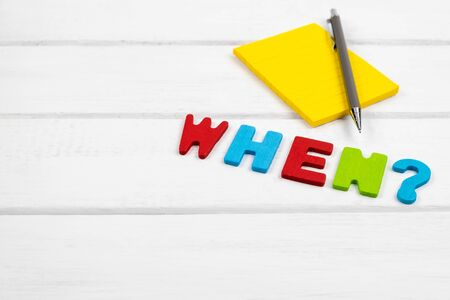 When wording on white wood background - concept of 5 Ws wh questions