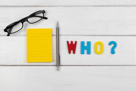 Who wording with empty note and pencil on white wood background - concept of 5 Ws wh questions
