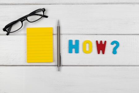 How wording with empty note and pencil on white wood background - concept of 5 Ws wh questions
