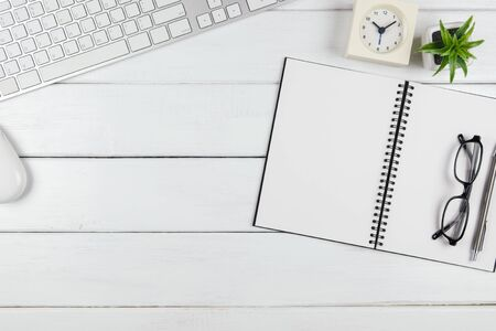 Top view of an empty blank open notebook on the minimal office desk
