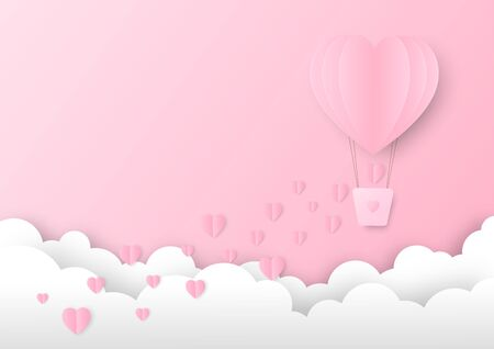 Pink paper heart shape balloon floating in the sky with some small hearts falling down. Concept of love and Valentine's Day.