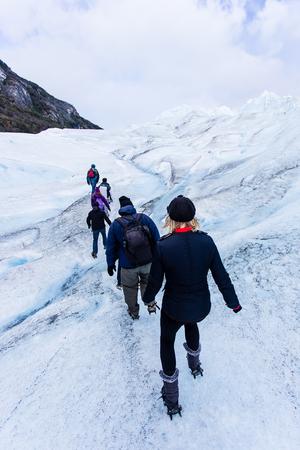 People trekking in glacier