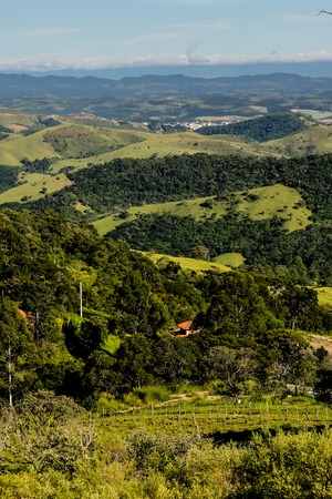 Mountain view from farm in Cunha, Sao Paulo. Mountain range in the background with green hills Stock Photo
