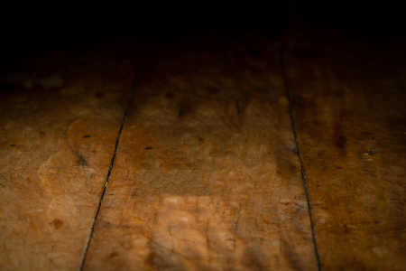 wooden pannel background to be used for product photography, background fade to black Imagens