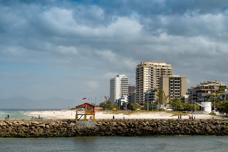 Pier in Barra da Tijuca beach, with lifeguard house. Rio de Janeiro, Brazil Stock Photo