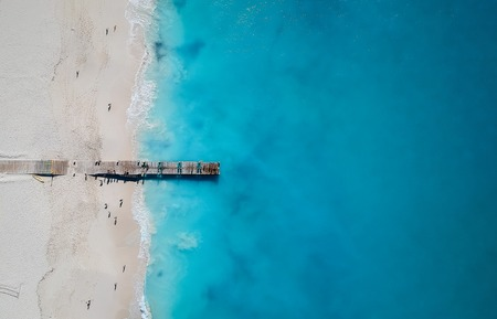 Drone photo of pier in Grace Bay, Providenciales, Turks and Caicos. The caribbean blue sea and white sandy beaches can be seen