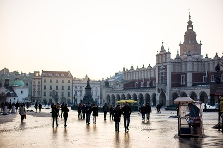 Krakow, Poland - Cisca February, 2014: Architecture of The Krakow Cloth Hall and Market Square at dusk, Poland. Krakow is the second largest and one of the oldest cities in Poland.
