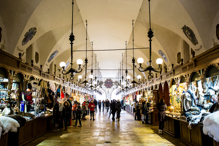 Krakow, Poland - Circa January, 2014: The crowded Cloth Hall gallery, or Sukiennice, located on Rynek Glowny, the main market square in the old town of Krakow.