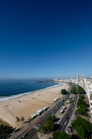 view of Copacabana beach right side during early morning, taken from the rooftop of a hotel, some slight fog can be seen on the blue sky. Rio de Janeiro, Brazil. Stock fotó
