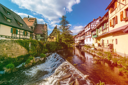 Weiss river in Kaysersberg, Alsace, on a sunny spring day
