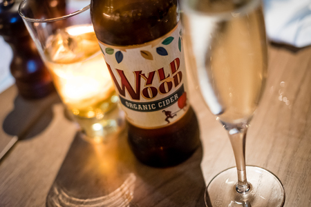 Edinburgh, Scotland - April 27, 2017: Restaurant table with alcoholic drinks, including Wyld Wood apple cider, a traditional drink in Scotland
