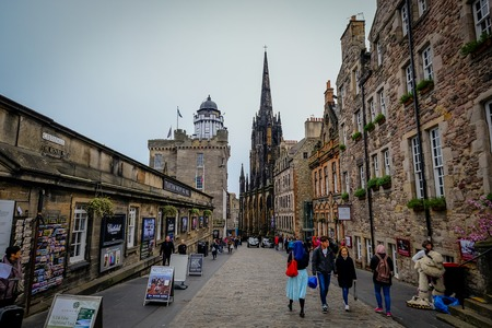 EDINBURGH, SCOTLAND - April 2017: Looking down the Royal Mile in the Old Town in Edinburgh Scotland. The Royal Mile is the most popular attraction in Edinburgh and hosts many tourists.
