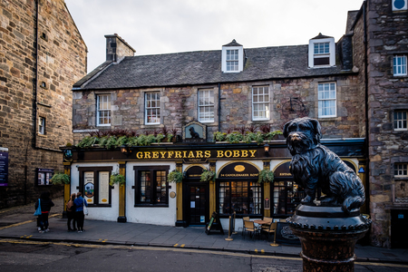 Edinburgh, Scotland - April 27, 2017: A statue of Greyfriars Bobby outside the Greyfriars Public House in Edinburgh, Scotland.