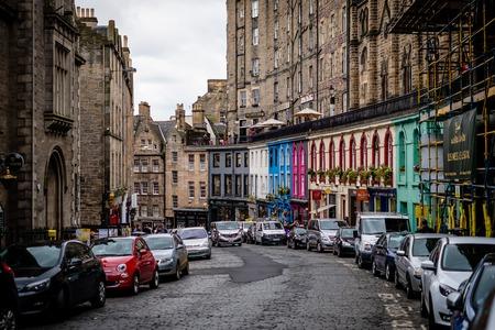 Edinburgh, Scotland - April 27, 2017: Victoria street a medieval street in Edinburgh that connects to the Grassmarket. popular tourist attraction and shopping precinct. Edinburgh, Scotland UK.