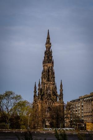 Edinburgh, Scotland - April 27, 2017: Statue of Sr Walter Scott at the base of the Scott Monument in Edinburgh Scotland. Scott is Scotlands most famous writer Redakční